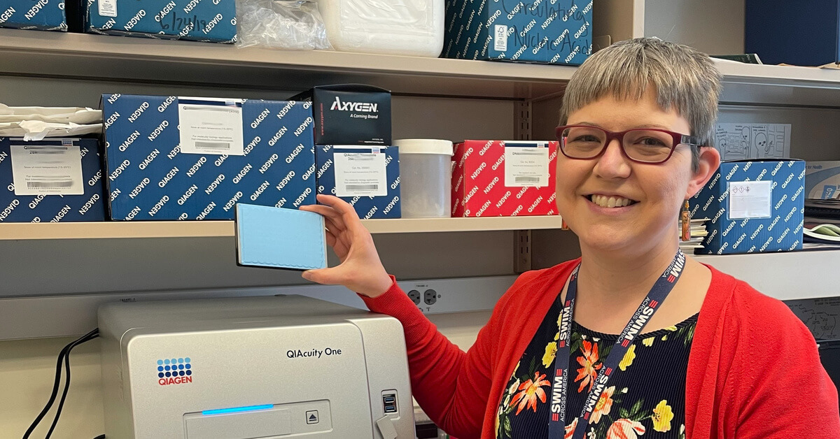 Amanda Winters with new digital PCR machine